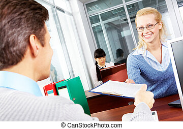 Employment - A manager giving a contract to his employee