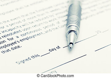 Employment agreement - Close-up of silver pen on employment...