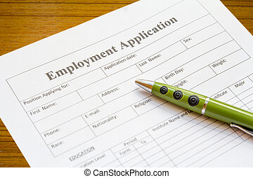 employment application - pen lying on the form of employment
