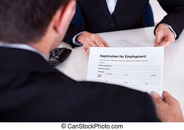 Employment interview and application form - Businessman...