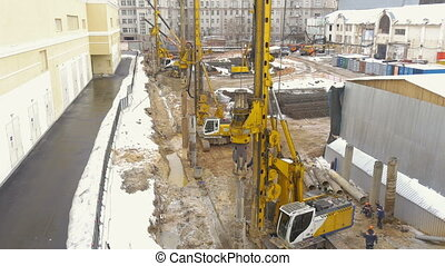Employment of construction equipment. Drilling of wells for the pillars. Timelapse.