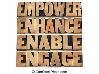 empower, enhance, enable and engage - motivational business concept - a collage of isolated words in letterpress wood type
