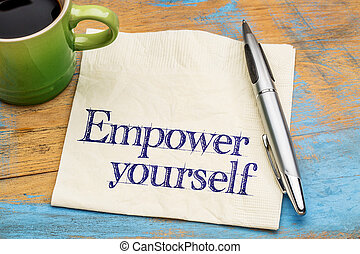 empower yourself - handwriting on a napkin with a cup of coffee