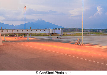 Empty airport runway during sunset