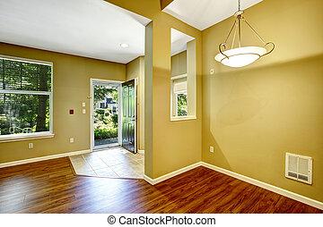 Empty apartment with open floor plan. Entrance hallway