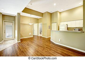 Empty apartment with open floor plan.