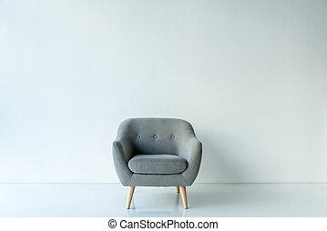 Empty armchair in room