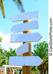 Empty arrow woode signs at beach