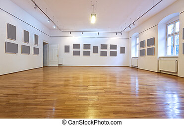 Empty art gallery with blank pictures on the wall - wide...