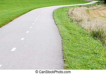 empty asphalt bike path in the country