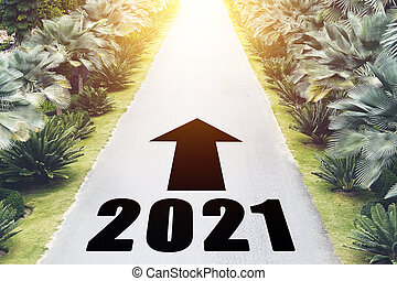 Empty asphalt road and New year 2021 concept. Driving on an empty road in the mountains to upcoming 2021 and arrows showing moving forward.