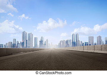 Empty asphalt road and skyscrapers in modern city