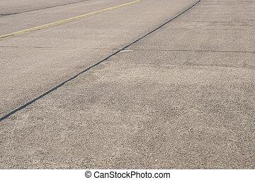 empty asphalt road / runway on former airport -