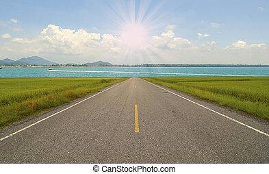 Empty asphalt road with blue sky