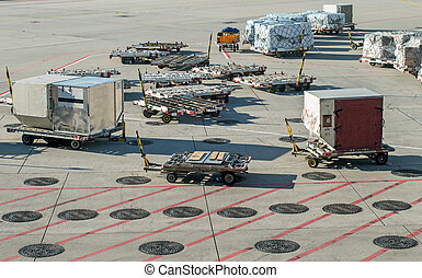 Empty baggage carts at the airport.