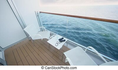 empty balcony of deck of ship with transparent handrail...