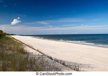 Baltic sea  - Empty Baltic sea beach with blue sky