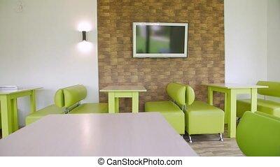 Empty bar quarantine sofas and tables camera movement