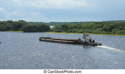 Empty barge on river on summer warm day