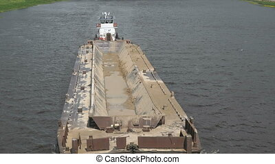 Empty barge on river on summer warm day - Top view of...