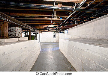 Empty basement in old house with white walls