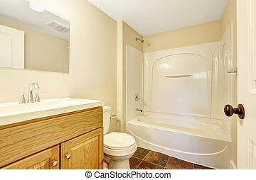 Empty bathroom with tile floor