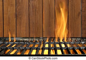 Empty BBQ Flaming Grill And Wood Wall In The Background - ...