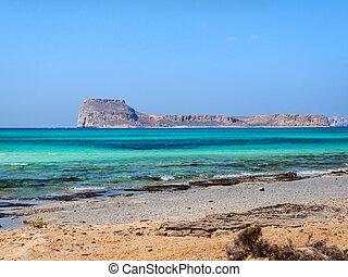 Empty beach and beautiful blue sea on the Balos beach overlooking the Gramvousa island