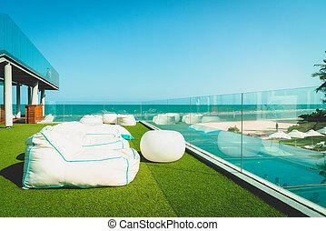 beach bean bag on balcony with ocean sea background