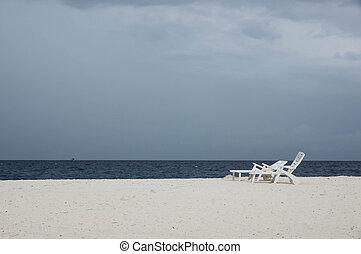Empty beach on a cloudy day in the rainy season