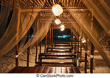 Empty beach restaurant lounge bar with lantern in the evening on tropical island