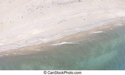 Empty beach. Top down, aerial view. Drone rotates. Lake...