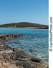Empty beach with blue water at Nissi beach ayia napa Cyprus. Famous tourist resort with clean water