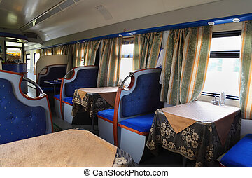 Empty, beautiful and comfortable restaurant with blue seats in train