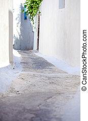 Empty beautiful street in a small town on Santorini, Greece