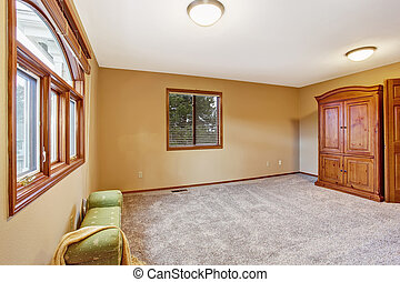 Empty bedroom interior in soft peach color with two windows, ottoman and wardrobe