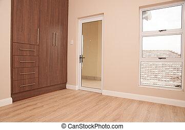 Empty Bedroom with Balcony