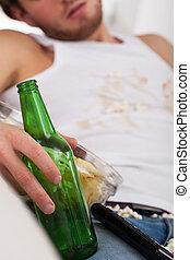 Empty beer bottle closeup