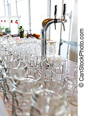 Empty beer glasses prepared by the barman for the guests of the event and participants of the big party.