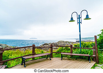 empty bench at Seaseom Park in Jeju Island, South Korea