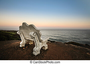 Empty bench at the sea - empty bench on cliff of ocean