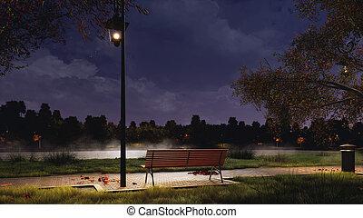 Empty bench in city park at dark autumn night