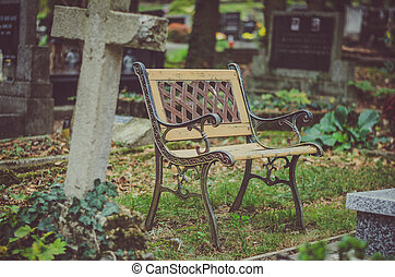 empty bench in the cemetery