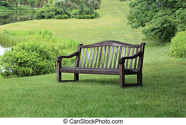 Empty Bench - Empty wooden bench in the part by the pond on...