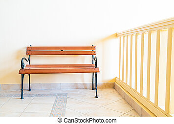 bench with yellow wall
