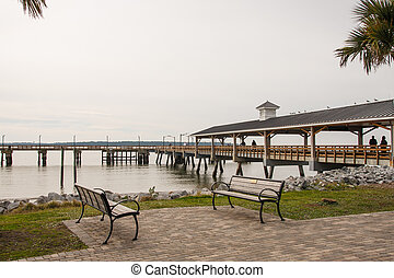 Empty Benches by a Winter Pier