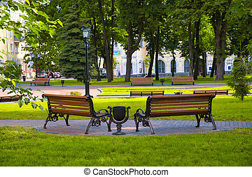Empty benches on a city alley in Chernihiv.