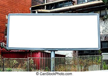 Empty billboard against urban background
