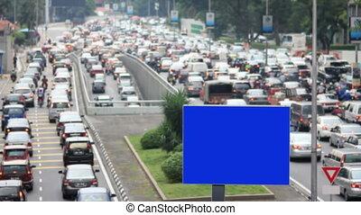 empty billboard in traffic jam