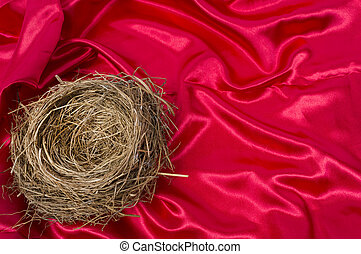 Empty Bird's Nest on a Beautiful Red Satin Background.